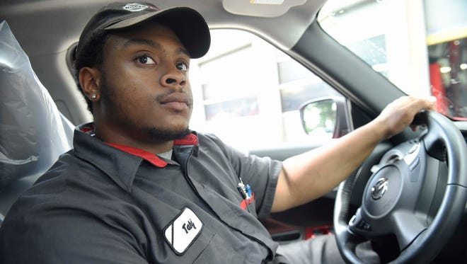 Tennessee Promise student Tahj Turnley drives a car to the car wash at the Nissan dealership in Cool Springs. He attends the Tennessee College of Applied Technology Hohenwald campus in Spring Hill.