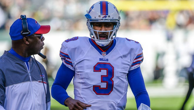 Buffalo Bills quarterback EJ Manuel (3) gets instructions from Buffalo Bills interim head coach Anthony Lynn in the game against the New York Jets during the 2nd quarter at MetLife Stadium.