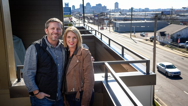 Matt and Martie Burnett stand on their balcony at 1st North with a view of downtown Nashville.  The Burnetts are building a second housing development along Dickerson Pike.