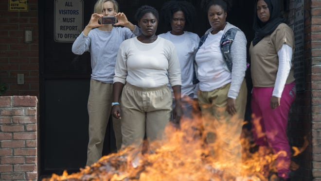 We're not sure we want to know what these Litchfield ladies are burning. (From left: Taylor Schilling, Danielle Brooks, Vicky Jeudy, Adrienne C. Moore, Amanda Stephen)