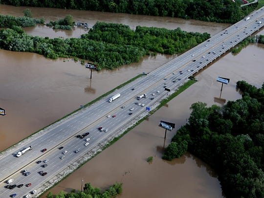 Traffic flows freely as floodwaters escape the banks