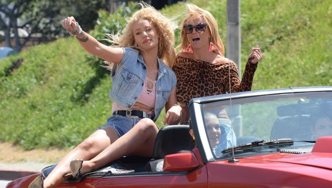 Iggy Azalea and Britney Spears on the set of their '80s-inspired 'Pretty Girls' music video on April 9, 2015, in Los Angeles.