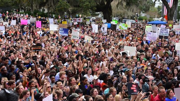 Protesters gather outside of the Florida Capitol on