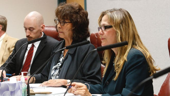 New Mexico Public Regulation Commissioners Lynda Lovejoy, center, and Valerie Espinoza, right, listen to complaints from AV Water Co. customers during a hearing on Oct. 12 at the San Juan County Administration Building in Aztec. The company is alleging the commission violated state law by assessing more than $2 million in fines against it.