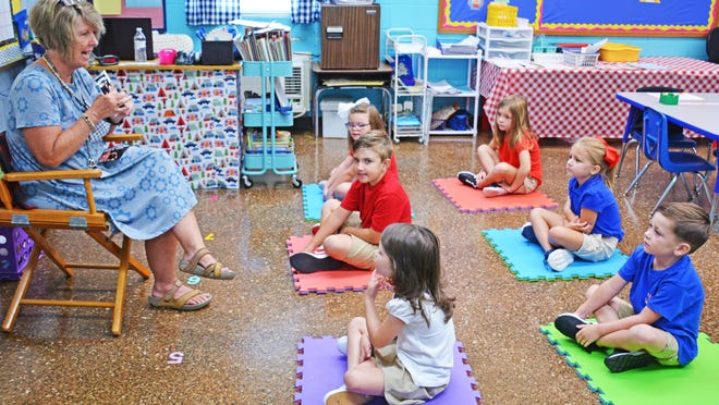 Lisa Zissette works on an activity with her K5 students on the first day of school at Jefferson Davis Academy on August 10. Zissette, who is a retired public school teacher, is one of several new teachers hired this year.