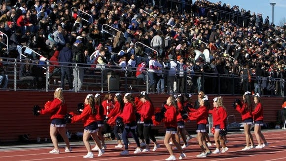 The Stepinac cheerleaders entertain the crowd during