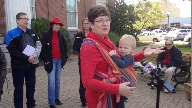 Julia Tate-Keith holds her 17-month-old son, Liam, while speaking about her concerns for proposed legislation that would create a burden on lesbian couples obtaining a birth certificate for their child during a Slate of Hate Press Conference Monday on the west grounds of the Rutherford County Courthouse.