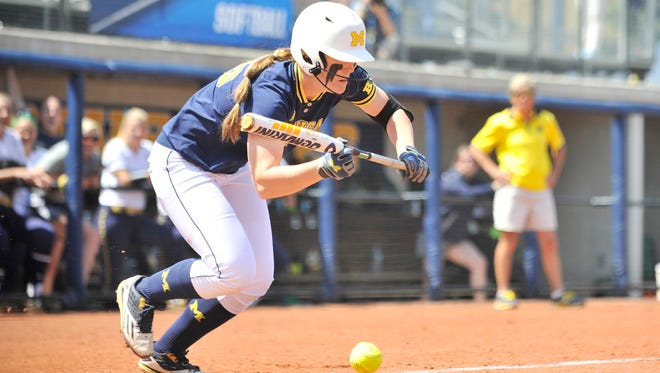 Faith Canfield hit a solo homer for Michigan in its season-ending loss to Washington on Sunday.