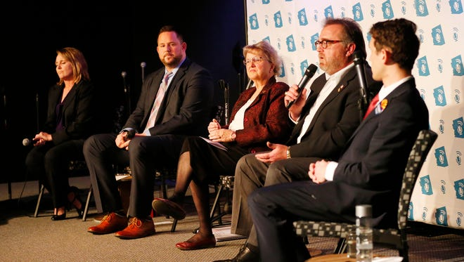 Candidates (from left) David Schapira, Diane Douglas, Bob Branch and Jonathan Gelbart attend a Scottsdale forum in February about the superintendent's role in education.