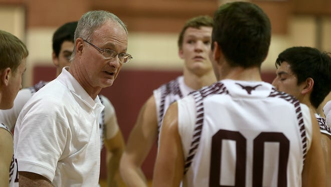 Bronte High School basketball coach Rocky Rawls talks to his team during a timeout during the fourth quarter of Friday night's game against Veribest in Bronte, Jan. 16, 2017.