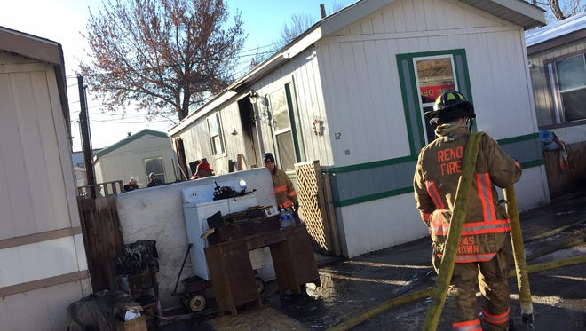 Reno firefighters clean up after a fire Friday that killed two puppies and left one resident homeless.
