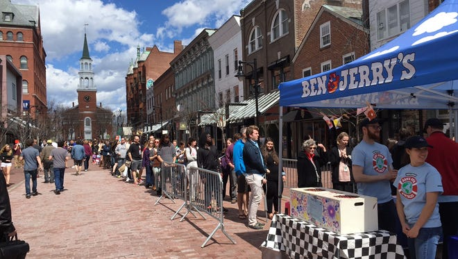A large line stretches up Church Street Marketplace in Burlington Tuesday for Free Cone Day at Ben & Jerry's.