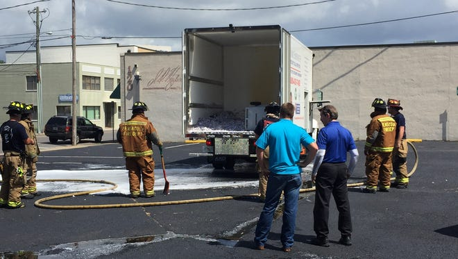 Pensacola Fire Department fire fighters on the scene of a vehicle fire at a parking lot at 200 South Baylen Street.