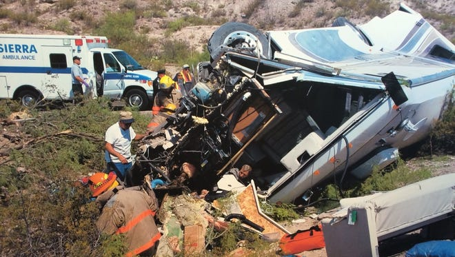 This photo, taken on June 14, 2003, shows emergency personnel working to free LeRoy Haeger and members of his family from their motorhome, which was en route to a symposium in New Mexico via Interstate 25 when the right front tire blew. LeRoy could not control the   38-foot-long RV as it swerved off the freeway and tumbled over an embankment, skidding on its side. When the screeching ended and the dust settled, LeRoy was trapped against the steering wheel, which had to be sawed off by emergency workers.