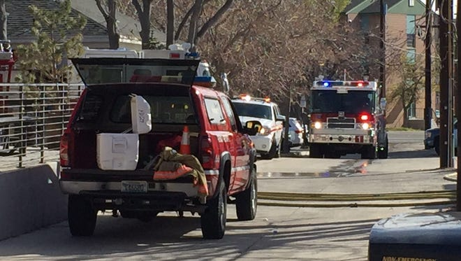 Reno fire crews work the scene of a duplex fire in the 200 block of Stewart Street on Monday morning, April 4, 2016.