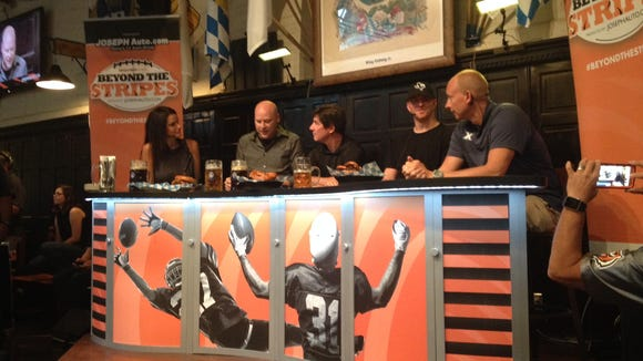 There was some talk at Beyond the Stripes, but the main attraction at Hofbrau Haus Tuesday was the Pop-a-Shot contest between Bengals quarterback Andy Dalton (left) and Xavier basketball coach Chris Mack (right). Mack won, 39-37.