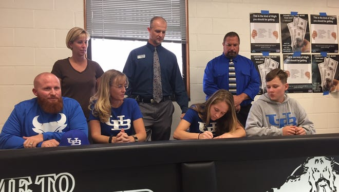 Mariner senior Journi Northorp signs her national letter of intent to join the University of Buffalo swimming team next year. The Tritons diver heads into the Class 2A championships as a state title contender.