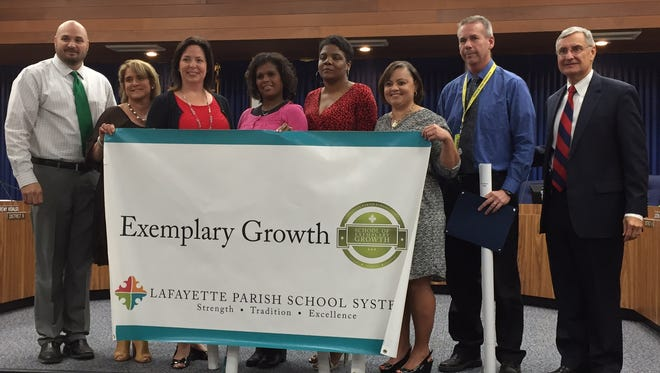 Lafayette Parish Superintendent Donald Aguillard (far right) celebrates with principals of Schools of Exemplary Growth, according to the state's new performance scores. The exemplary growth schools are Acadiana High, Northside High, Comeaux High, Alice Boucher Elementary, Ossun Elementary, Lafayette High and Broadmoor Elementary.