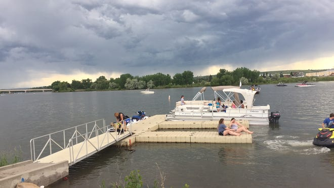 Broadwater Bay on the Missouri River in Great Falls was busy with boaters at 3:30 p.m. Sunday. The National Weather Service has forecast severe thunderstorms for the area.