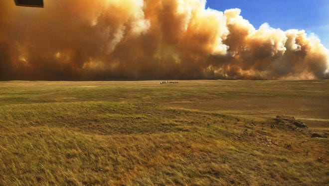 A fire burns in the Milk River Natural Area in Alberta just across the border from Montana.