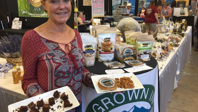 Deb Wheaton, CEO and co-founder of Gluten-Free Prairie, displays some of the company's gluten-free oat-based projects.