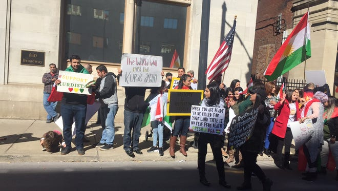 Several hundred people hold a peaceful protest in support of Kurdistan Wednesday, Oct. 25, 2017