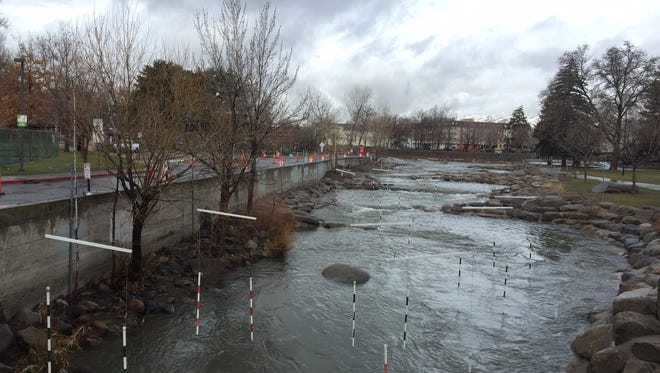 The Truckee river runs through downtown Reno after a morning of rain Wednesday, March 21, 2018.