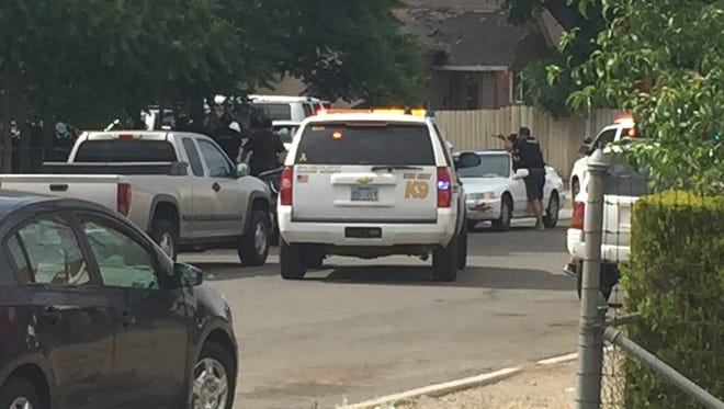 Police and sheriff's deputies are involved in an apparent armed standoff near 6th and Spokane streets in Reno.