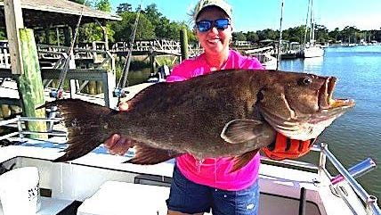 Savannah-area angler Alli DeYoung is all smiles as she shows this trophy-size scamp grouper caught recently while fishing with Capt. Judy Helmey aboard the Miss Judy II.