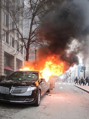A limousine burns during protests in Washington, D.C., on Inauguration Day Friday. Amanda J. Cain photo.