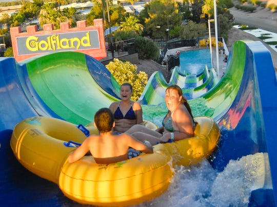 These sliders hang on for a fast drop at Golfland Sunsplash water park June 19, 2010, in Mesa.