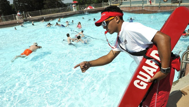 Devauntay Beasley keeps an eye on the swimmers in the wave pool during the busy Memorial Day weekend at Nashville Shores. Sunday May 24, 2015, in Nashville, TN