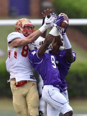 Furman's Aaquil Annoor (9) and Rodney Anderson (5) break up a pass intended for VMI's Samuel Patterson (80).