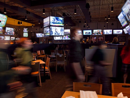 Patrons file into the Buffalo Wild Wings in Genoa Township