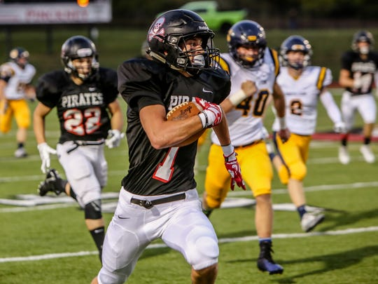 Pinckney's Nick Cain returns a kickoff 97 yards for one of his four touchdowns in a 45-30 victory over South Lyon.