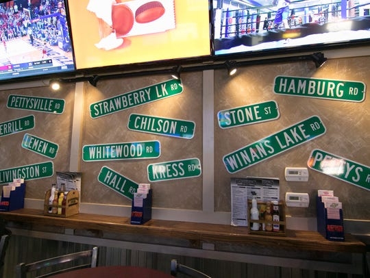 Street signs, shown Thursday, Jan. 25, 2018, are among