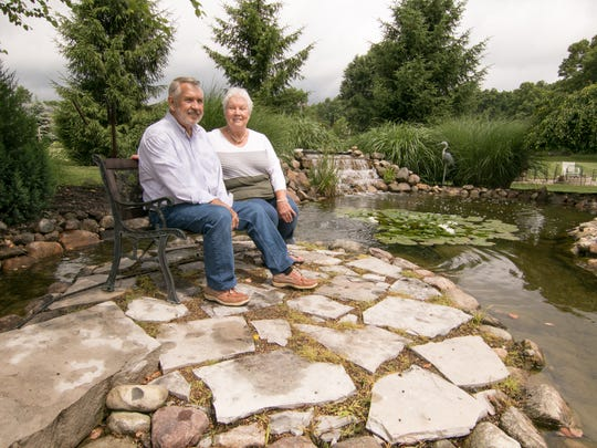 A seating area within the pond Howard and Cissy Anderson had installed on their property, shown Wednesday, June 27, 2018, provides a serene vantage point.