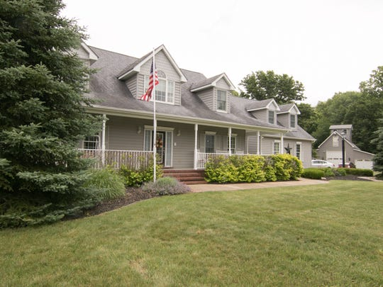 The three-level barn and garade added onto the Andersons' property, shown Wednesday, June 27, 2018, seems to tie into the style of the home.