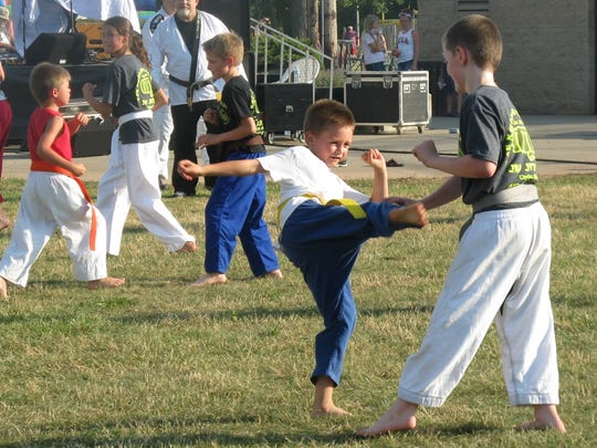 Students from Hills Martials Arts demonstrate their skills on July 1 in Clyde Community Park.