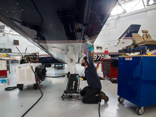 Aircraft mechanic Mike Leonard works on an aircraft's wing at Heritage Aviation at the Burlington International Airport in South Burlington on Wednesday, January 13, 2016.