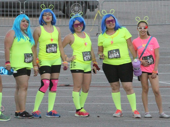 Participants in the Texas Tech University Health Sciences of El Paso's Groove and Glow 5K usually dress up with a focus on neon colors for the annual event.