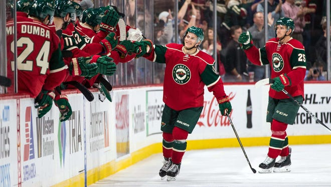 Minnesota Wild forward Teemu Pulkkinen (17) celebrates his goal during the second period against the Los Angeles Kings at Xcel Energy Center.