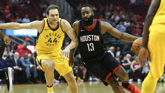 Houston Rockets guard James Harden (13) attempts to dribble the ball around Indiana Pacers forward Bojan Bogdanovic (44) during the first quarter at Toyota Center.