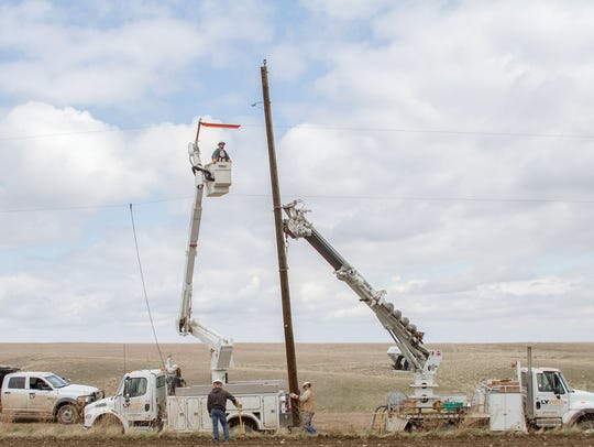 A linemen crew from Lower Yellowstone Rural Electric