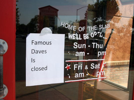 Sign on Famous Dave's, Westridge Shopping Center, Salinas. Hours have been scratched off.