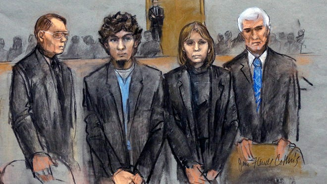 In this courtroom sketch, Dzhokhar Tsarnaev, second from left, stands with his  attorneys William Fick, left, Judy Clarke  and David Bruck as the jury presents its verdict April 8 in Boston.