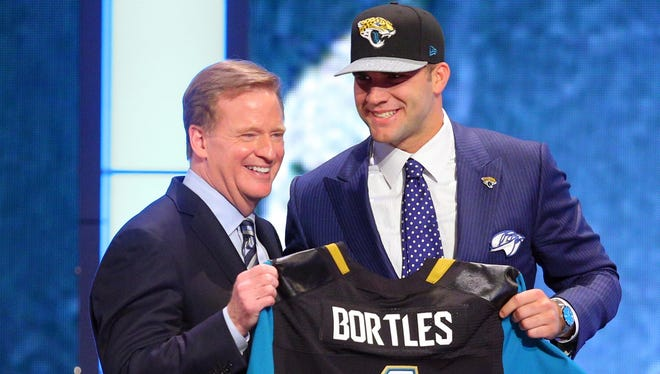 Blake Bortles of Central Florida poses for a photo with NFL Commissioner Roger Goodell after being selected as the No. 3 overall pick in the 2014 NFL Draft to the Jacksonville Jaguars.