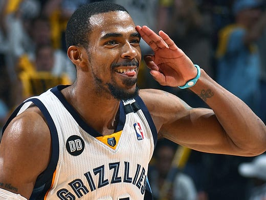 Memphis Grizzlies guard Mike Conley (11) celebrates