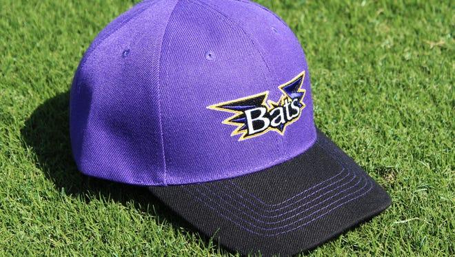 Louisville Bats' purple cap.