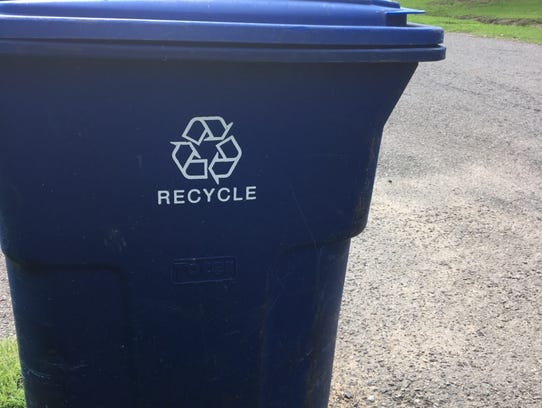 The blue recycling cart provided to city residents.